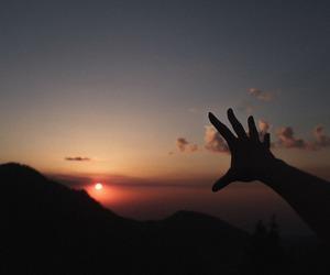 sunset, sun, and sky image
