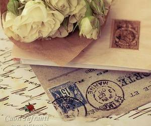 letters, white roses, and old image