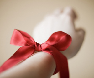 bow, hand, and red image
