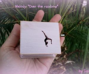 gymnastics, music box, and over the rainbow image