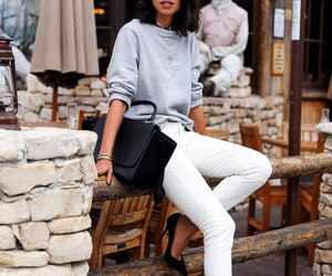 stilettos, white jeans, and grey sweater image