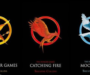 mockingjay, catching fire, and hunger games image