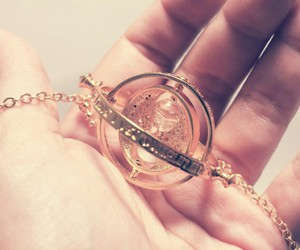 harry potter, hand, and necklace image