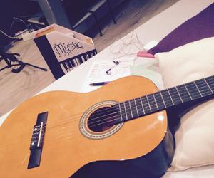 music, writing, and guitar image