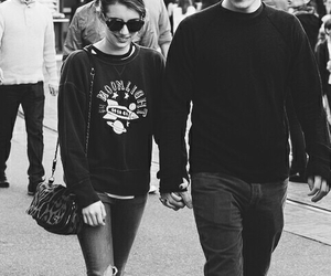 emma roberts, evan peters, and couple image