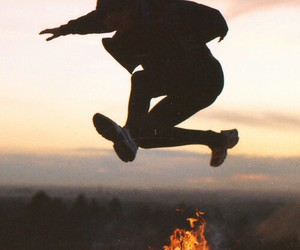 fire, boy, and jump image