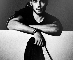 sam claflin, catching fire, and black and white image