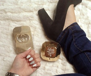gold, paco rabanne, and gucci guilty image