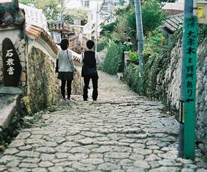 cobblestone, couple, and far away image