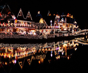 river, village houses, and decorated with lights image
