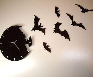 clock, bat, and black image