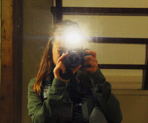 brunette, green, and camera image