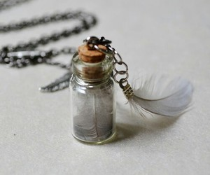 bottle, feather, and grey image
