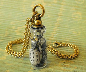 bottle, necklace, and time image
