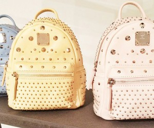 studded backpack and pastel backpack image