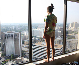 girl, city, and window image
