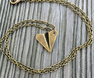 airplane, necklace, and origami image
