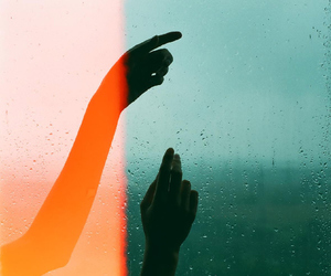 hands and rain image