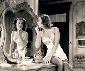 corset, mirror, and pin-up image