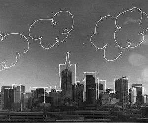 city, clouds, and black and white image
