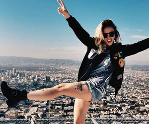 girl, city, and fun image