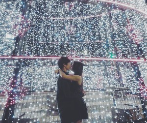 city, couple, and lights image