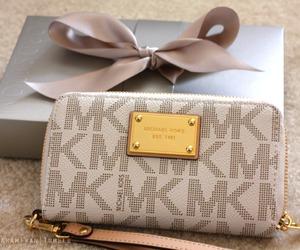 Michael Kors, wallet, and bag image