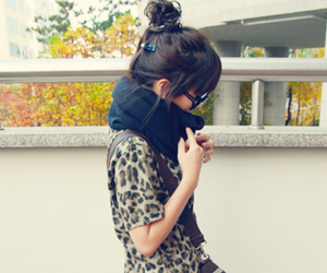 bun, leopard print, and scarf image