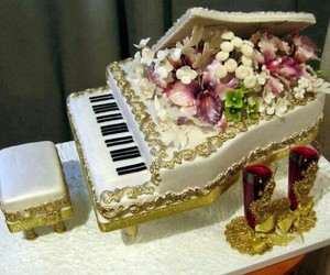 cake, piano, and flowers image
