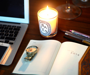 candle, macbook, and watch image