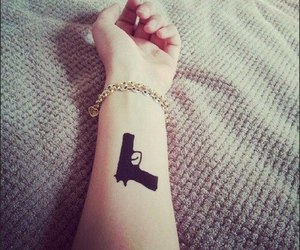 gun and tattoo image