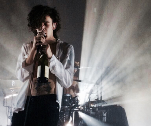 the 1975, matty healy, and concert image