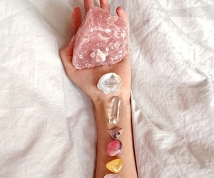 crystal, stone, and hand image