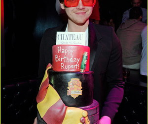 rupert grint, harry potter, and cake image