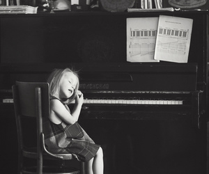 little girl, notes, and piano image