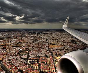 city, sky, and airplane image