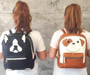 white t-shirt, light brown hair, and black backpack image
