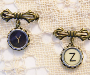 typewriter key, bronze jewelry, and initial pin image