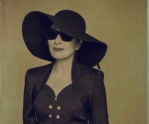 black hat, black sunglasses, and floppy hat image