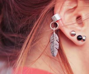 earrings, ear, and feather image