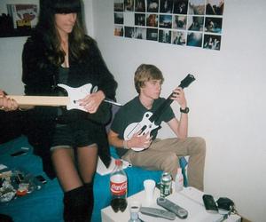 girl, boy, and guitar image