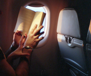 book, couple, and plane image