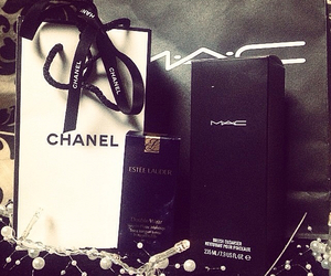 black, chanel, and estee lauder image