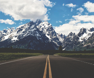 mountains, road, and sky image