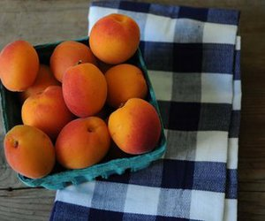 peaches, plaid, and wood image