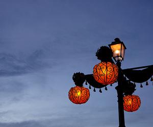 black, lamp post, and orange image