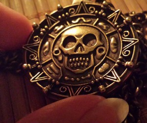 medallion and pirates of the caribbean image