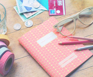 notebook, book, and glasses image
