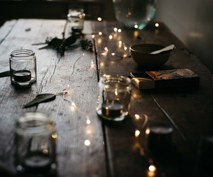 light, candle, and table image