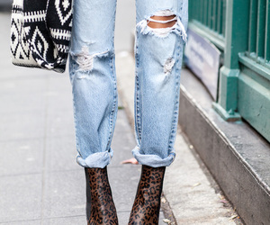 boots, boyfriend jeans, and heels image